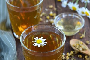 Camomile Tea on wooden background