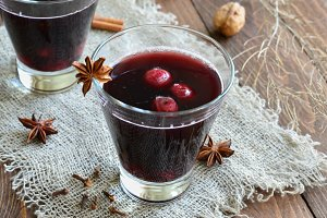 Cherry Drink, Mulled Wine on wooden background