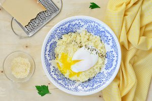 Millet Porridge with Poached Egg and Grated Cheese