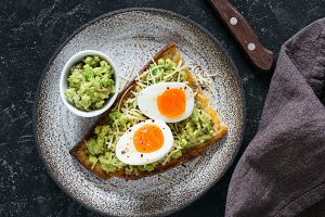 Toast with egg and avocado guacamole