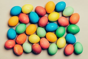 Colorful eggs on a creamy background