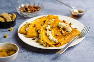 Pumpkin Crepes with Cream Cheese Filling, Pecan and Maple Syrup