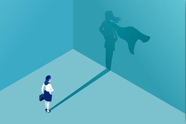 Businesswoman superhero shadow