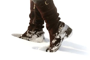 Brown women's shoes covered by snow in the winter