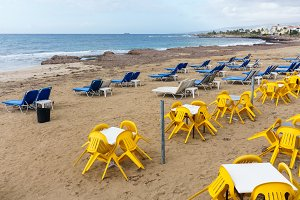 Photos of coastal zone with sun loungers and tables