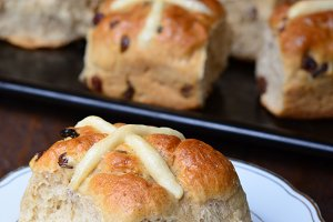 Easter Hot Cross Buns on dark background