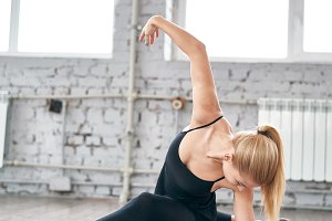 Graceful girl while doing ballet positions