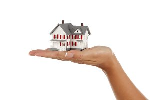 Model House in Female Hand Isolated