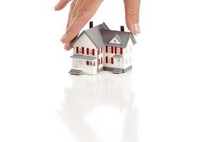 Womans Hand Choosing A Home