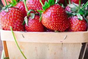 Long stemmed strawberries in basket
