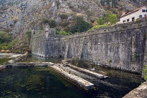 wall of an old stone fortress by the water