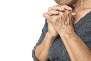 hands of old woman praying