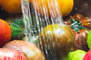 Rinsing colorful tomatoes
