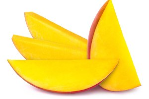 Four mango slices isolated