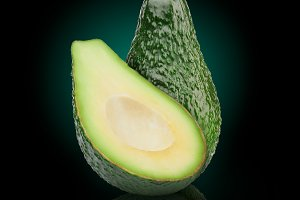 Green avocado with slice isolated