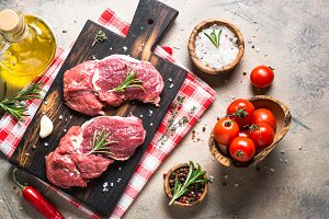 Raw beef steak rib eye with cooking ingredients.