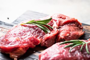 Raw beef steak rib eye with herbs.