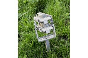 streetlight illuminator is installed on the lawn.