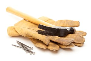Hammer, Gloves and Nails Isolated on