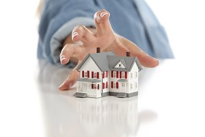 Womans Hand Reaching for House
