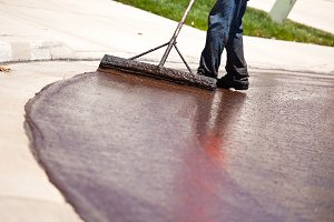 Road Worker Resurfacing Street