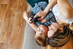 Mother and son playing on tablet PC
