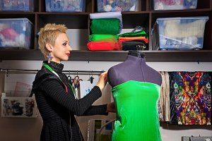 Fashion designer working with dummy