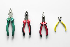 Flat lay of various pliers isolated