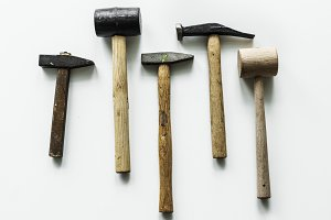 Flat lay of various hammers