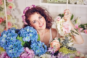 Attractive girl with flowers.