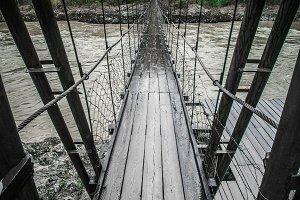 Wooden bridge over a mountain river