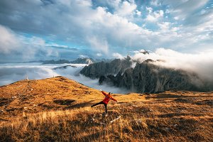 Traveler stands at Tre Cime