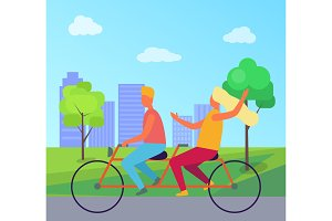 Couple Riding Double Bicycle in Summer Park