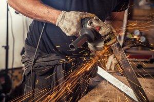 Close up of a man grinder metal