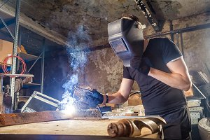 Man welds metal