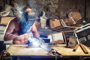 Man welds metal