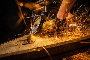 Close up of worker cutting metal