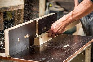 Carpenter works at wooden