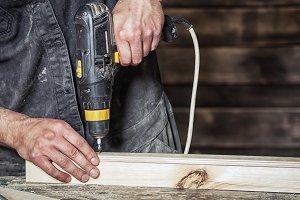 Man a screw with a screwdriver