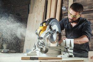 Man saws a modern circular saw