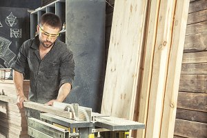 Man cutting it with a circular saw