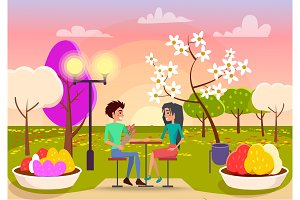 Couple in Love Sits at Table on Sunset in Park