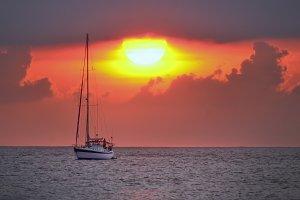 Yacht and sun sinking