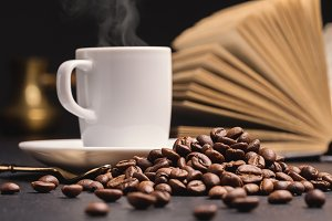 Coffee beans, coffee, open book.
