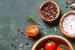Food background on dark stone table.