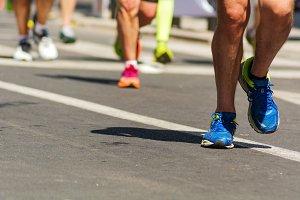 running shoes of marathon runners