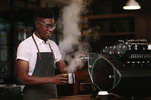 Coffee shop owner preparing coffee