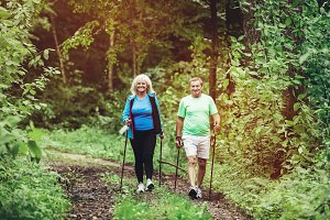 Senior couple trekking in the woods