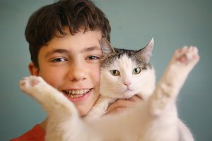 photo of cat lover teenager boy hug cat close up funny photo