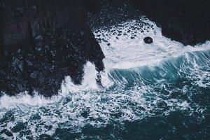 Dark Cliffs and Crashing Waves